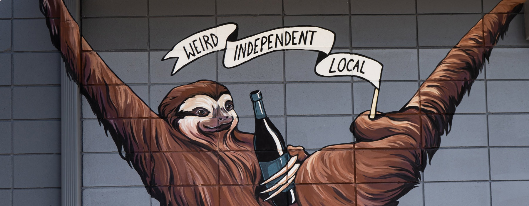 local business wall painting of a sloth