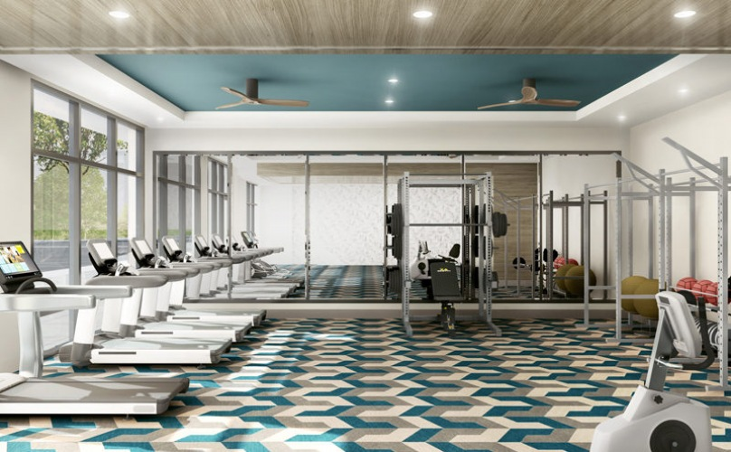 Fitness center has large floor-to-ceiling windows